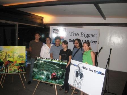 Some of the artists with smaller versions of billboard art