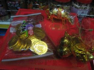 gold chocolate coins, the carabao, and other items (carp, pineapple, round objects)