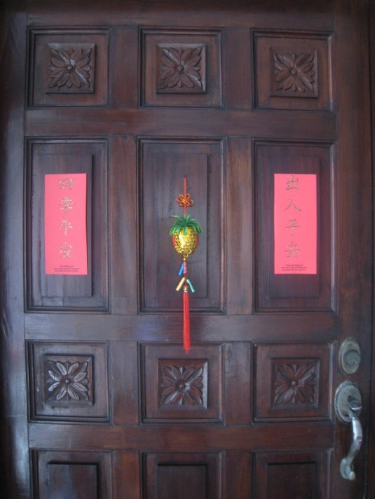 Our main door with the couplet on both sides to wish good luck for the people living inside