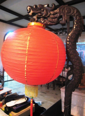 Our antique dragon lantern stand and a RED lantern always spruce up the living room
