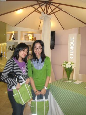 My girls with their Clinique bags