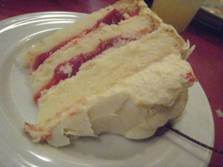 See how nothing was spared to fill the innards of this cake with cream & cherry bits? Yummy!